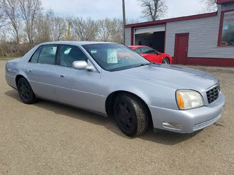 2004 Cadillac DeVille for sale at BARNES AUTO SALES in Mandan ND