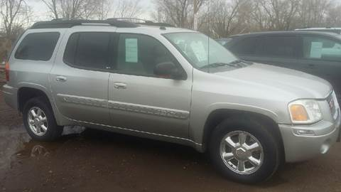 2004 GMC Envoy XL for sale at BARNES AUTO SALES in Mandan ND