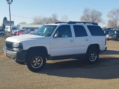 2004 Chevrolet Tahoe for sale at BARNES AUTO SALES in Mandan ND