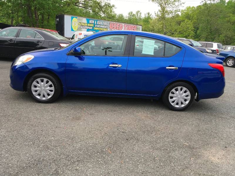2014 Nissan Versa for sale at D & M Discount Auto Sales in Stafford VA