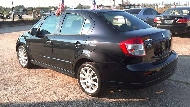 2009 Suzuki SX4 for sale at Texan Direct Auto Group in Houston TX