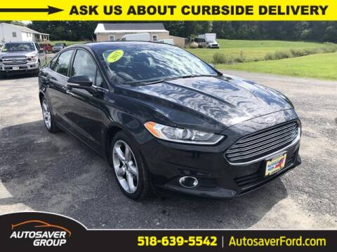 2015 Ford Fusion for sale at Autosaver Ford in Comstock NY