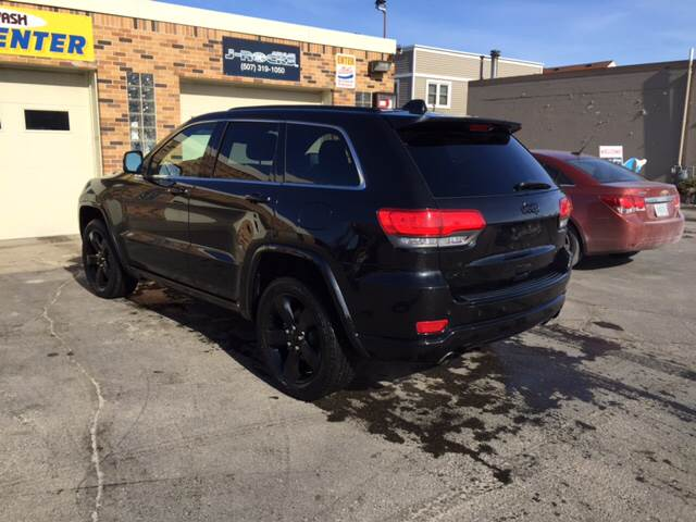 2015 Jeep Grand Cherokee for sale at Carney Auto Sales in Austin MN