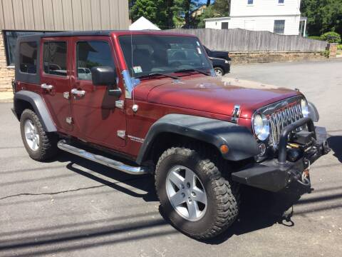 2009 Jeep Wrangler Unlimited for sale at 222 Newbury Motors in Peabody MA