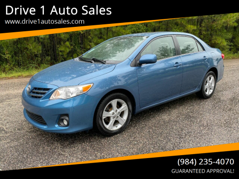 2013 Toyota Corolla for sale at Drive 1 Auto Sales in Wake Forest NC