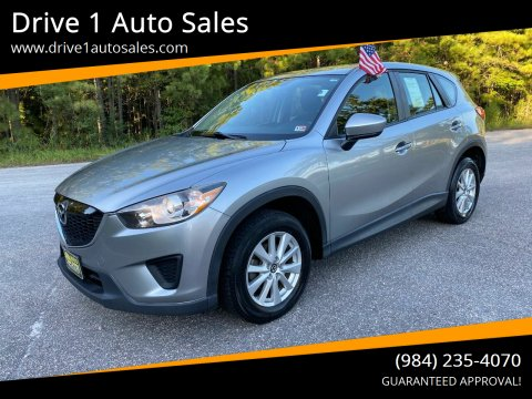 2013 Mazda CX-5 for sale at Drive 1 Auto Sales in Wake Forest NC