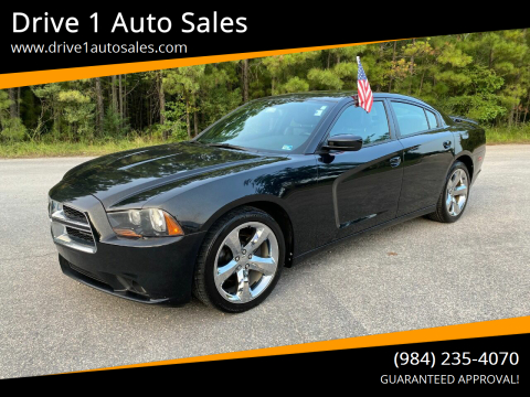 2013 Dodge Charger for sale at Drive 1 Auto Sales in Wake Forest NC
