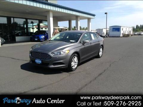 2014 Ford Fusion for sale at PARKWAY AUTO CENTER AND RV in Deer Park WA