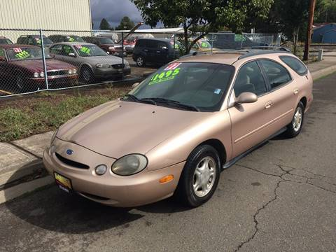 1997 Ford Taurus for sale at Car Safari LLC in Independence OR