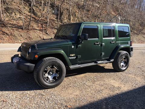 2012 Jeep Wrangler Unlimited Sahara for sale at DONS AUTO CENTER in Caldwell OH
