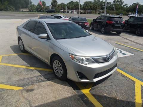 2014 Toyota Camry for sale at ORANGE PARK AUTO in Jacksonville FL
