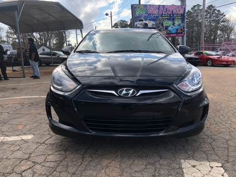 2013 Hyundai Accent for sale at Fast and Friendly Auto Sales LLC in Decatur GA