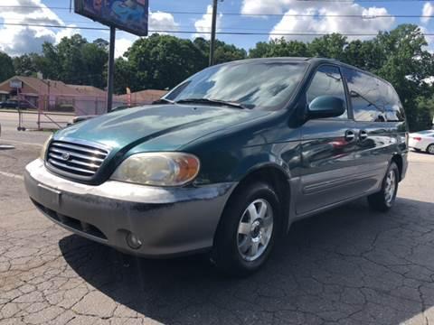 2002 Kia Sedona for sale at Fast and Friendly Auto Sales LLC in Decatur GA