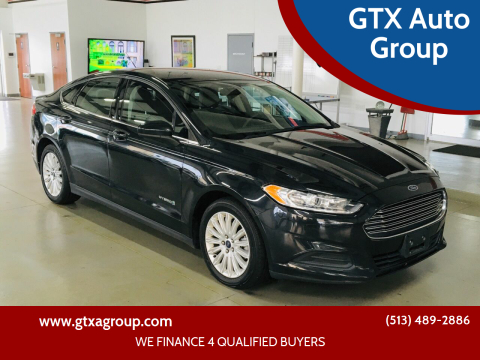 2014 Ford Fusion Hybrid for sale at GTX Auto Group in West Chester OH