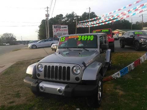 2015 Jeep Wrangler Unlimited for sale at AUTOPLEX 528 LLC in Huntsville AL