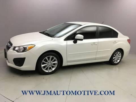 2014 Subaru Impreza 2.0i Premium for sale at J & M Automotive in Naugatuck CT