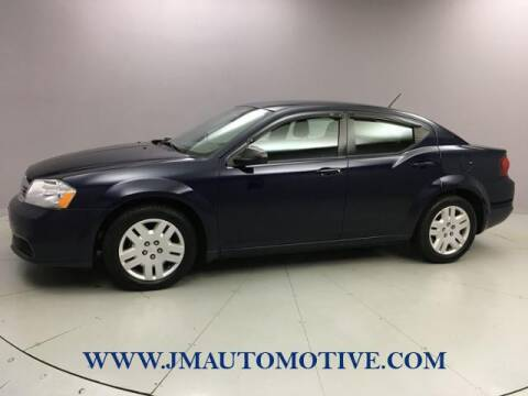 2014 Dodge Avenger for sale at J & M Automotive in Naugatuck CT