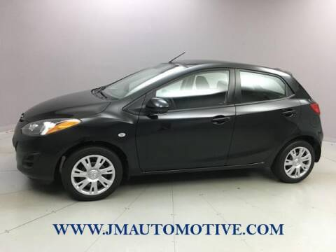 2014 Mazda MAZDA2 for sale at J & M Automotive in Naugatuck CT