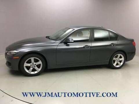 2014 BMW 3 Series for sale at J & M Automotive in Naugatuck CT