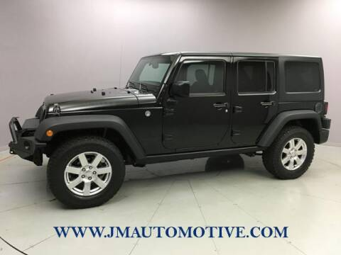 2016 Jeep Wrangler Unlimited for sale at J & M Automotive in Naugatuck CT