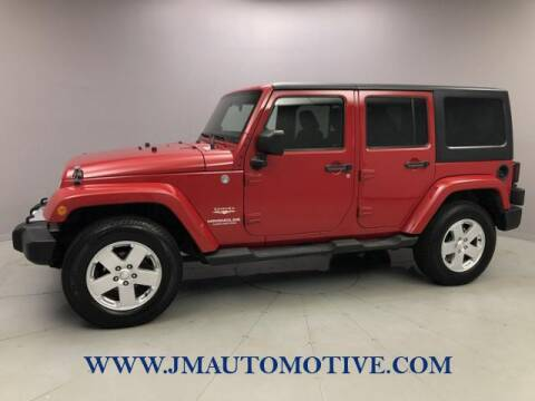2011 Jeep Wrangler Unlimited for sale at J & M Automotive in Naugatuck CT
