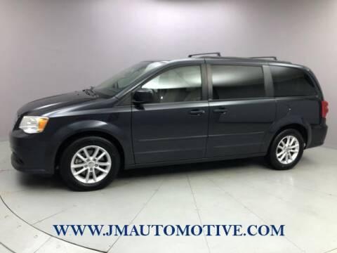 2014 Dodge Grand Caravan for sale at J & M Automotive in Naugatuck CT