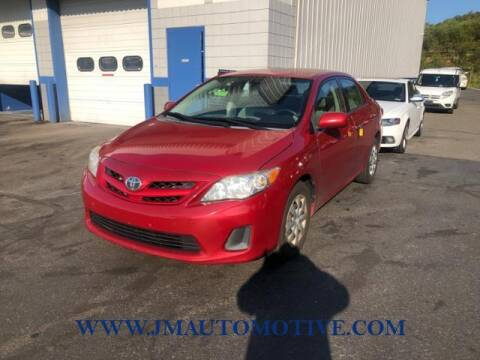 2011 Toyota Corolla for sale at J & M Automotive in Naugatuck CT