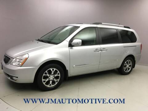 2014 Kia Sedona for sale at J & M Automotive in Naugatuck CT