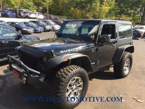 2013 Jeep Wrangler for sale at J & M Automotive in Naugatuck CT