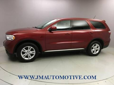 2013 Dodge Durango for sale at J & M Automotive in Naugatuck CT