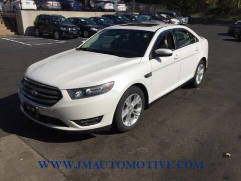 2014 Ford Taurus for sale at J & M Automotive in Naugatuck CT