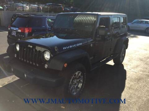 2014 Jeep Wrangler Unlimited for sale at J & M Automotive in Naugatuck CT