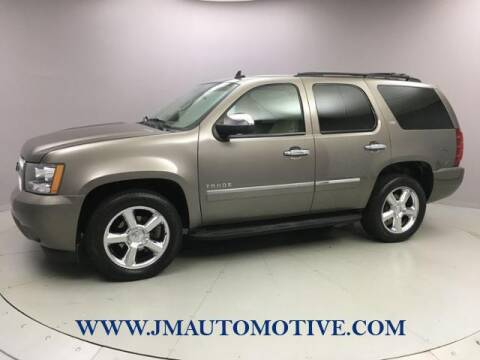 2011 Chevrolet Tahoe for sale at J & M Automotive in Naugatuck CT