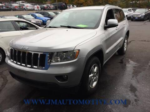 2011 Jeep Grand Cherokee for sale at J & M Automotive in Naugatuck CT