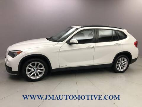 2015 BMW X1 for sale at J & M Automotive in Naugatuck CT