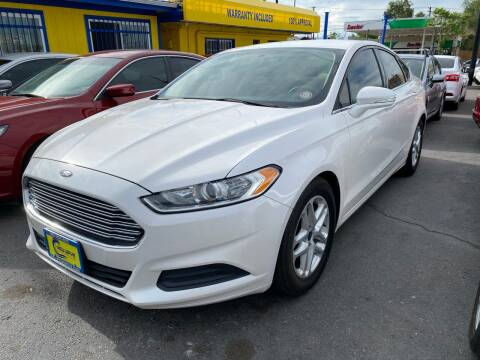 2015 Ford Fusion for sale at New Wave Auto Brokers & Sales in Denver CO