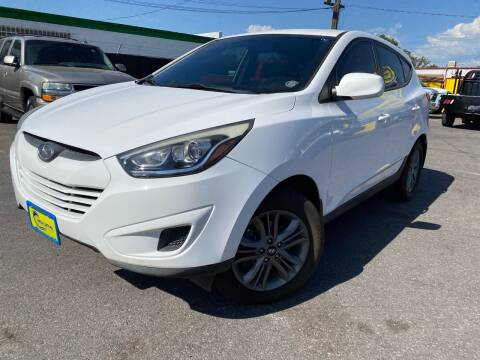 2015 Hyundai Tucson for sale at New Wave Auto Brokers & Sales in Denver CO