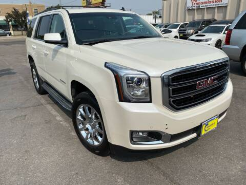 2015 GMC Yukon for sale at New Wave Auto Brokers & Sales in Denver CO