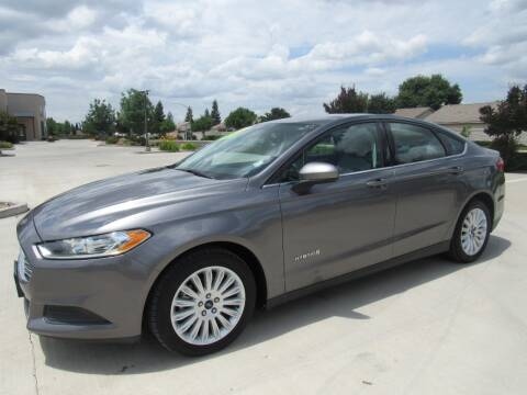 2014 Ford Fusion Hybrid S for sale at Repeat Auto Sales Inc. in Manteca CA