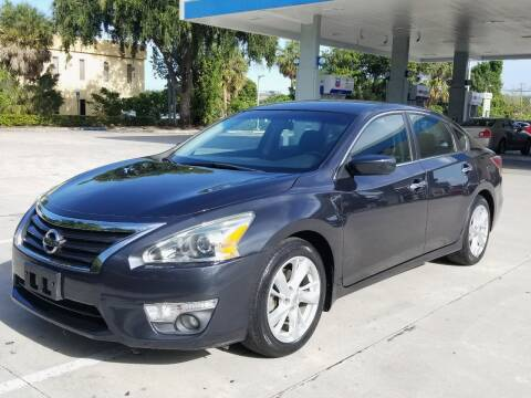2015 Nissan Altima for sale at YOUR BEST DRIVE in Oakland Park FL