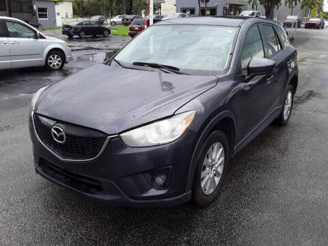 2015 Mazda CX-5 for sale at YOUR BEST DRIVE in Oakland Park FL