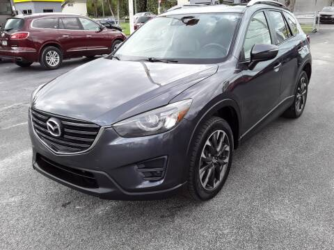 2016 Mazda CX-5 for sale at YOUR BEST DRIVE in Oakland Park FL