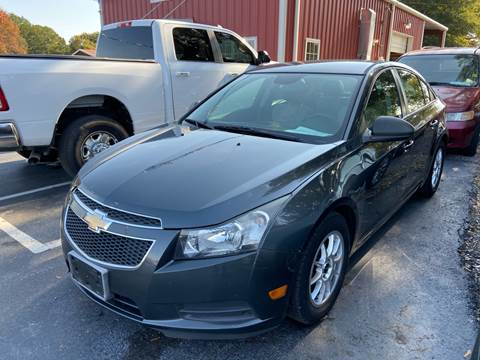 2013 Chevrolet Cruze for sale at Sartins Auto Sales in Dyersburg TN