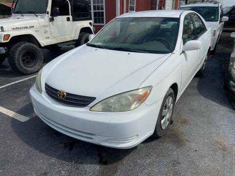 2003 Toyota Camry for sale at Sartins Auto Sales in Dyersburg TN