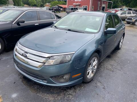 2012 Ford Fusion for sale at Sartins Auto Sales in Dyersburg TN