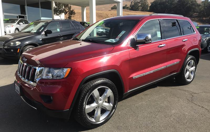 2012 JEEP GRAND CHEROKEE LIMITED 4X4 4DR SUV red need financing we can help call now call toda