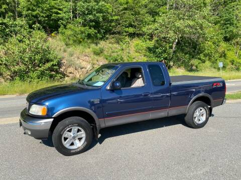2002 Ford F-150 XLT for sale at Johnsons Auto Sales, LLC in Marshall NC
