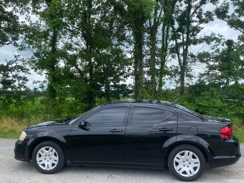 2012 Dodge Avenger for sale at RAYBURN MOTORS in Murray KY