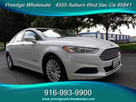 2014 Ford Fusion Hybrid for sale at Prestige Wholesale in Sacramento CA