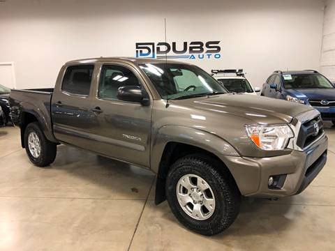 2015 Toyota Tacoma for sale at DUBS AUTO LLC in Clearfield UT